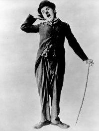 Charlie Chaplin yawning.